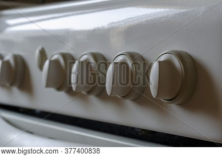 Close Up White Dirty Knobs With Drops Of Fat. Knob Dial Of Control Panel Gas Stove For On Off Or Adj
