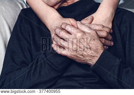 Daughter Supports And Takes Care Of Her Elderly Father During Qu
