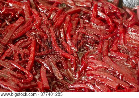 Raw Red Beet Strips And Olive Oil. Raw Beets Sliced Into Cubes Background. The Process Of Roasting R