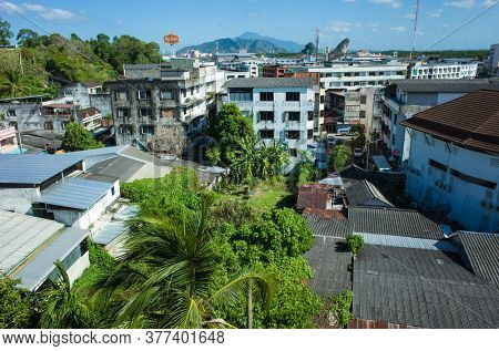 Krabi, Thailand - February 12, 2020: Roofs, walls and backstreets of downtown Krabi town