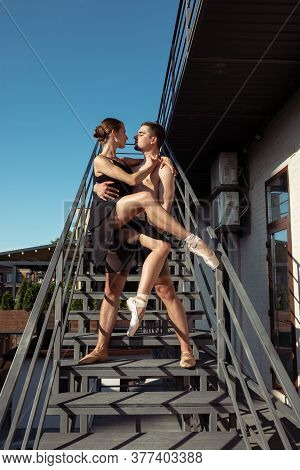 Couple Of Modern Ballet Dancers Performing On The Stairs At The City. Fast Moving Of Citylife, Grace