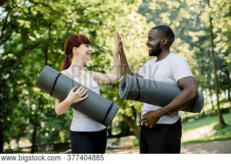 Active Smiling Multiethnic Couple, Ready For Workout In Park. Couple, Caucasian Woman And African Ma