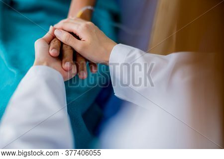 Asian Woman Doctor Encouragement And Supportive To Cansor Patient After Consult And Examine In Clini