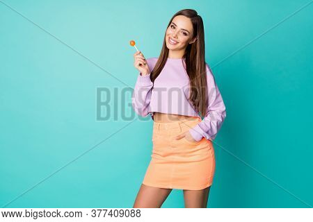 Photo Of Pretty Funny Lady Hold Lollipop Candy Hands Good Mood Sweets Addicted Person Wear Cropped P