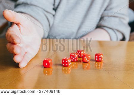 Female Hand Throwing Six Red Dices On The Table. Yamb, Dice Game