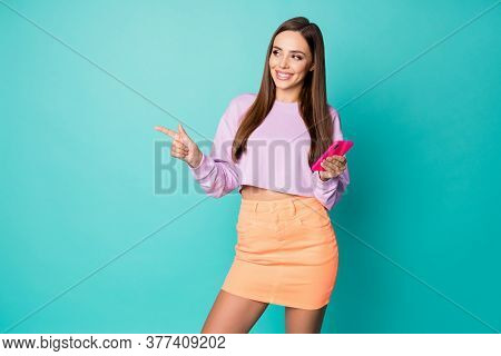 Photo Of Attractive Lady Hold Telephone Hand Direct Finger Side Empty Space See Cool Advert Wear Cro