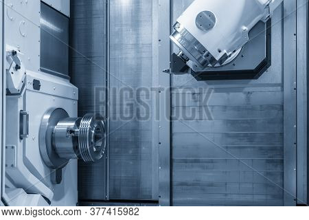 The Multi-tasking Machining Center Cutting The Automotive Parts. Hi-precision Manufacturing Process
