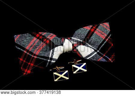 Plaid Bow Tie And Scottish Saltire Cuff Links Isolated Against S Black Background
