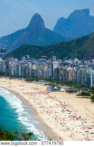 Copacabana beach in Rio de Janeiro, Brazil. Copacabana beach is the most famous beach of Rio de Janeiro, Brazil. Skyline of Rio de Janeiro