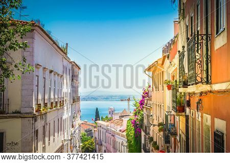 Street With In Old Town Of Lisbon, Portugal With Sunshine