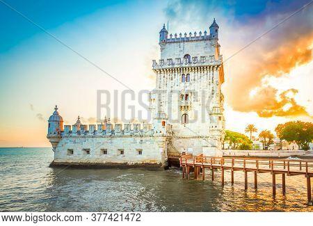 Torre Of Belem At Sunset, Famouse Landmark Of Lisbon, Portugal With Sunshine