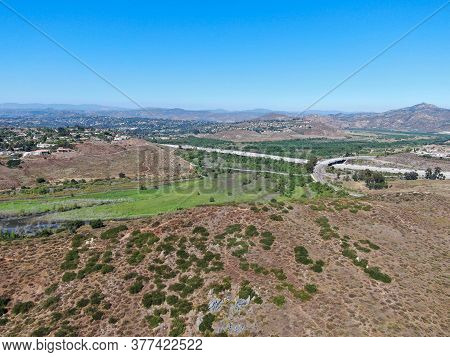 Aerial View Of Rancho Bernardo Mountain With Freeway Road On The Background, East San Diego County,