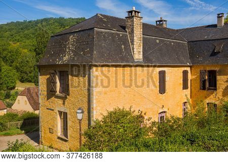 Saint Amand de Coly; Dordogne; France - August 13; 2019: Perigord Noir, Saint Amand de Coly typical houses, labelled Les Plus Beaux Villages de France - The Most Beautiful Villages of France