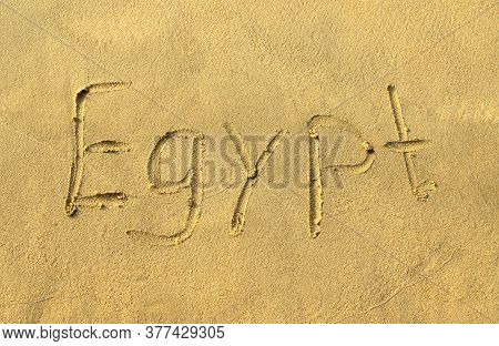Egypt Word On Beach Sand. Egypt Letters Is Written On A Sand. Handwriting