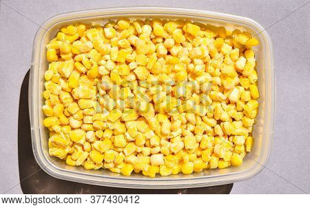Corn In A Plastic Container For Long-term Storage. Deep Freezing Of Vegetables. Frozen Food Vegetabl