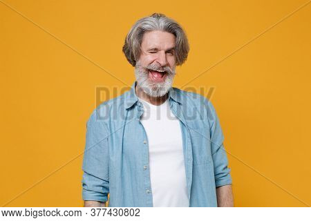 Cheerful Elderly Gray-haired Mustache Bearded Man In Casual Blue Shirt Posing Isolated On Yellow Bac