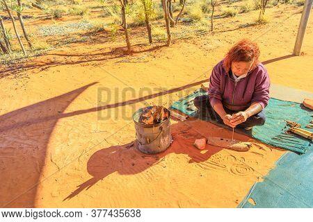 Kings Creek Station, Northern Territory, Australia - Aug 21, 2019: Indigenous Australians Woman Craf