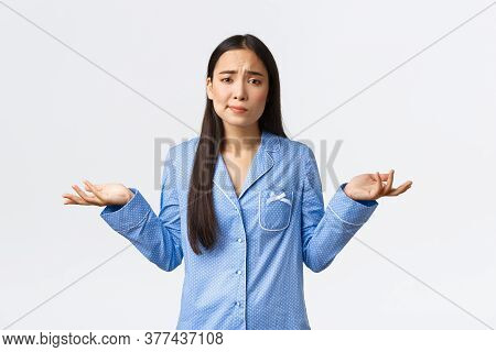 Puzzled And Confused Asian Girl Cant Decide, Dont Know What Do, Standing In Blue Pajamas, Smirk Comp