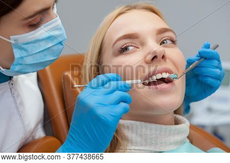 Female Dentist Working At Her Dental Clinic