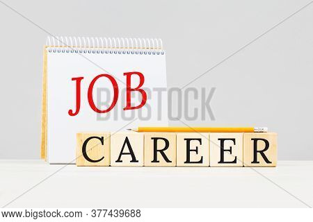Job And Career Text On Notepad With Pencil On Grey Background. Planning A Career Or Job Hunt Or Offe