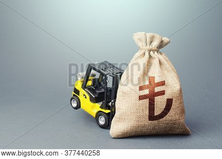 Yellow Forklift Unable To Lift A Turkish Lira Money Bag. Interest Rate. Strongest Financial Assistan