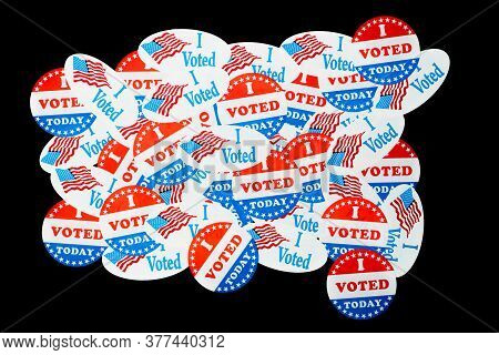 Many Voting Stickers Given To Us Voters In Presidential Election For Background To Illustrate Vote R
