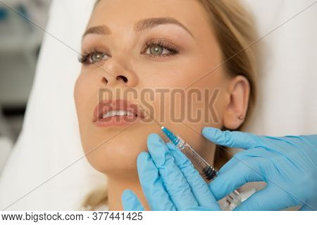 Top View Close Up Of A Beautiful Young Woman Enjoying Face Massage At The Spa Massaging Relaxing Rec