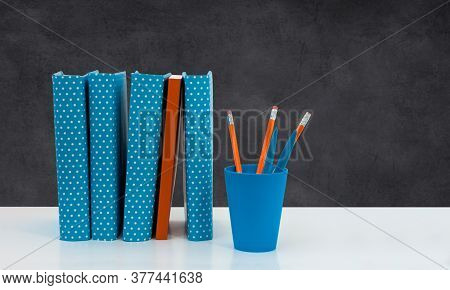 Back To School, Pile Of Books With Empty Black School Board Background. Distance Home Education. Qua