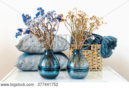 Cozy Home Interior Decor: Pillow, Plaid, Vase With Flowers On A White Shelf In The Room. The Quarant