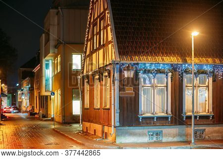 Parnu, Estonia. Night View Of Corner Of Uus And Nikolai Streets With Old Houses In Evening Night Ill