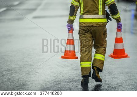 Transportation System Theme. Highway Worker Preparing For Road Closure Moving Two Traffic Cones. Tra