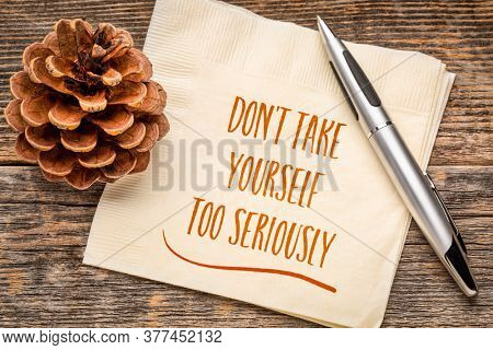 Do not take yourself too seriously - handwriting on a napkin,mindset and attitude concept