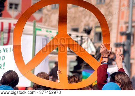 People Holding Up A Big Peace Sign At A Really, Peace Movement On A Demonstration