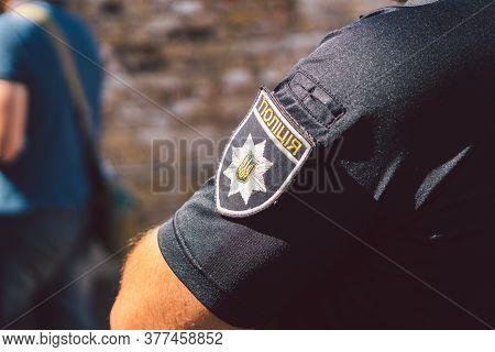 Police Of Ukraine, Badge Of Ukrainian Police Close Up. Police Patrol Ukraine. Kiev. Chevron On The S