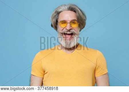 Cheerful Funny Elderly Gray-haired Mustache Bearded Man In Casual Yellow T-shirt, Eyeglasses Posing