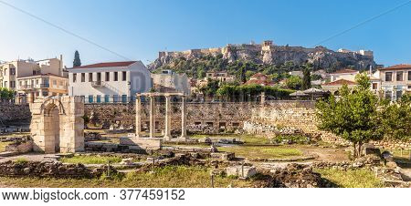 Panoramic View Of Library Of Hadrian, Acropolis In Distance, Athens, Greece. It Are Famous Tourist A