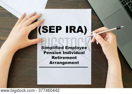 Paper With Simplified Employee Pension Individual Retirement Arrangement Sep Ira On A Table