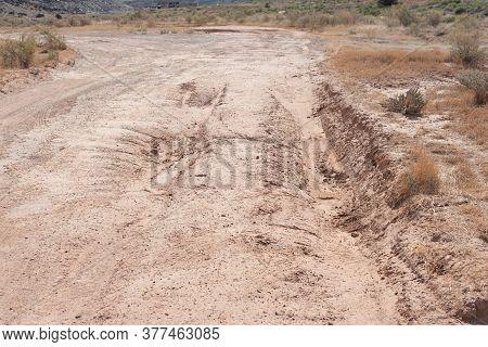 Rutted Dirt Road After A Summer Rain In The Desert
