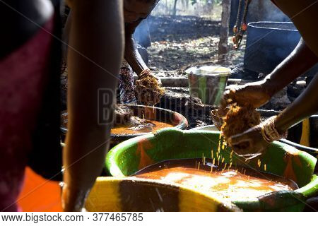 African Women Preparing Palm Oil In A Rural Village. Rural Background, Poverty Context