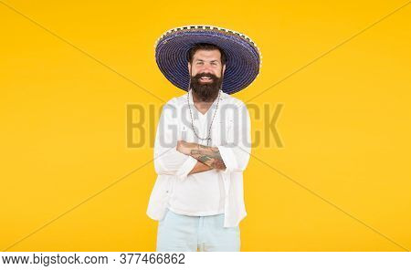 Man In Mexican Sombrero Hat. Vacation Concept At Resort In Mexico. Hipster With Beard Looks Festive
