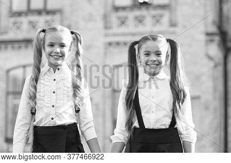 Ending Of School Year. Lucky To Meet Each Other. Cheerful Smart Schoolgirls. Happy Schoolgirls Outdo