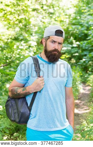 Relaxing Hiking Experience. Bearded Man Carry Backpack. Ready For Camping. Male Tourist Wear Cap. Sp
