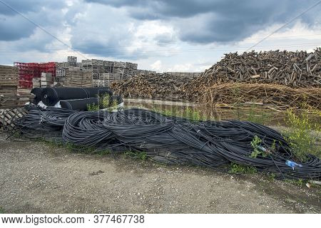 Firewood, Crates, Plastic Pipes And Safety Nets
