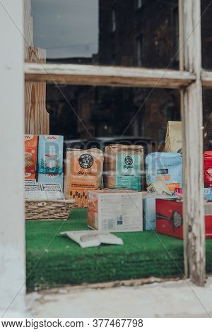 Stow-on-the-wold, Uk - July 6, 2020: View Through Window Of Products On Window Display Of Organic Sh