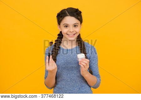 Be New Today. Brunette Little Girl Applying Powder On Her Face. Face Cosmetics. Portrait Beautiful K