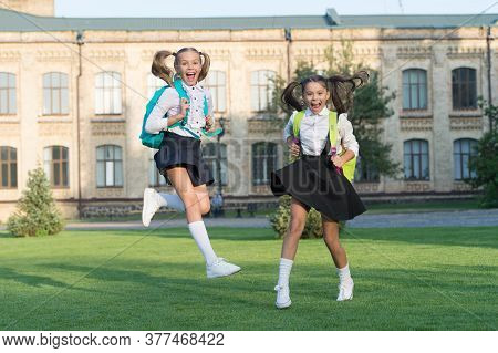 Excited Happy Girls School Uniform Running, Sincere Happiness Concept.