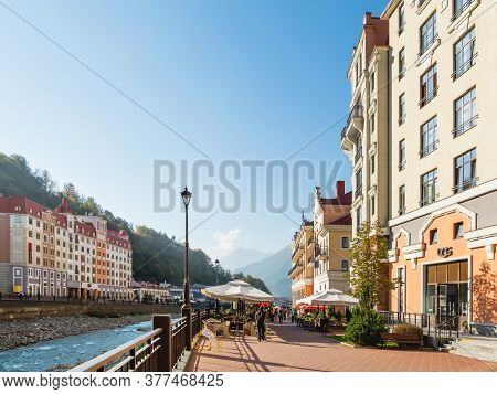 Sochi, Russia - October 13, 2018. Tourists Walk On Mzymta River Embankment In Rosa Dolina. Famous Ro