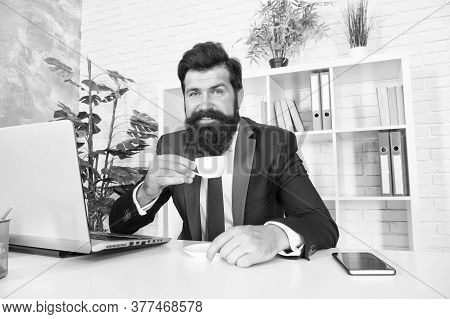 Man Handsome Boss Sit In Office Drinking Coffee. Comfy Workspace. Bearded Hipster Formal Suit Relaxi