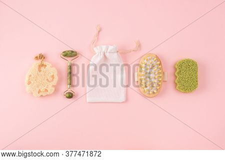 Anti Cellulite Massager, Bamboo Sponge, Face Jade Roller, Cotton Bag, Loofah Sponge On Pastel Pink.