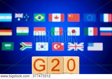 G20 Concept. Wooden Blocks With The Inscription G20 And The Flags Of The Countries Participating In
